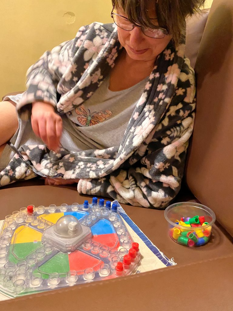 Person we support playing a board game