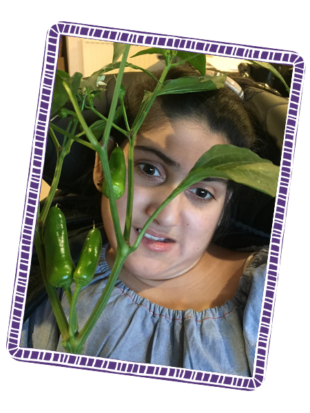 Rhea with her homegrown chilli plant!