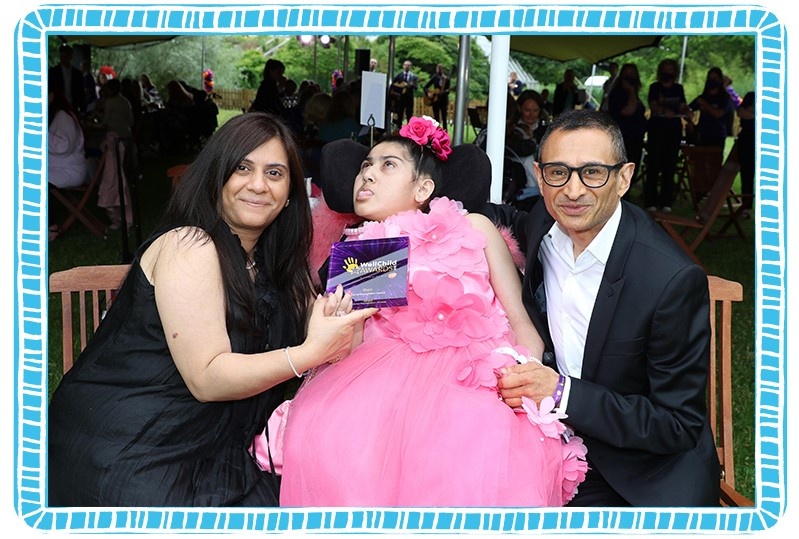 Rhea with her Mum Purabi, posing with her WellChild Special Recognition award! Image courtesy of WellChild.